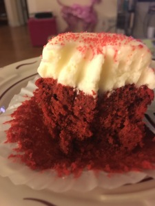 "Half eaten ""oops I forgot to take a photo"" red velvet cupcake!!!"